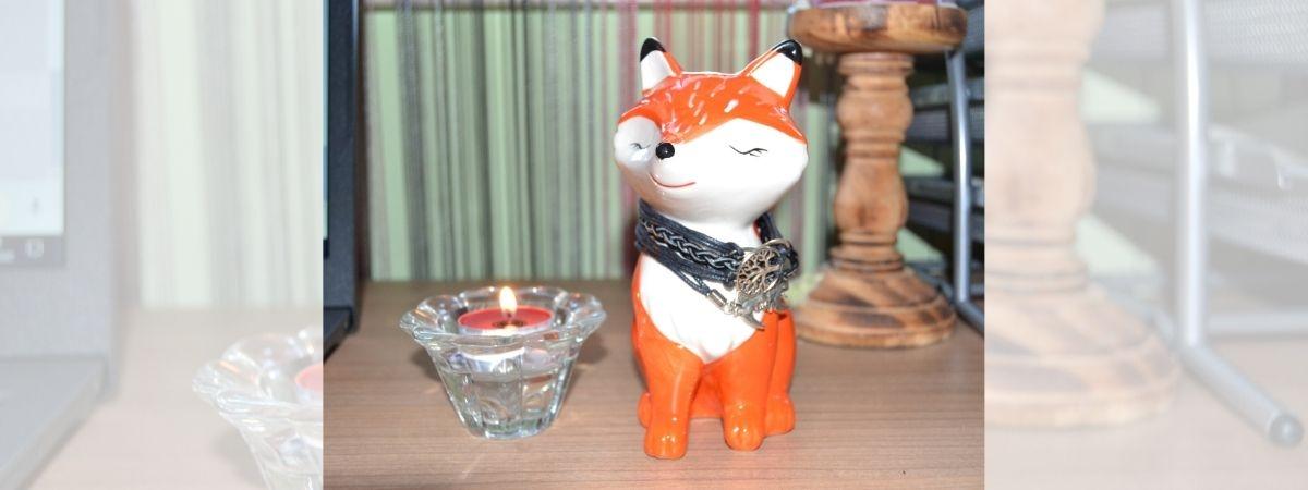 RobinGrips Fuchs neben Kerze